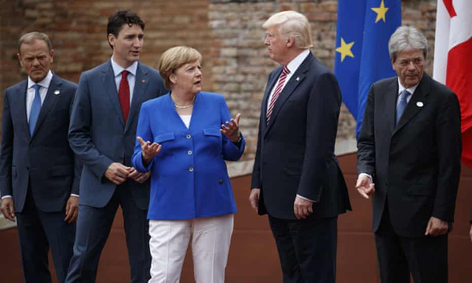 Donald Trump at the G7 meeting in May with Donald Tusk, Justin Trudeau, Angela Merkel and Paolo Gentiloni. The US president has persistently low ratings across Europe.