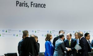 French President Francois Hollande shakes hands with United Nations secretary general Ban Ki-moon at the COP 21 climate conference in Paris, which approved the text of a historical global agreement on climate change.