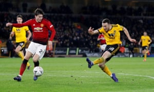 Diogo Jota escapes the attentions of Victor Lindelöf to fire home Wolves' decisive second goal at Molineux.
