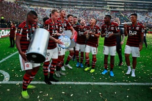 Lincoln, Matheus Dantas and Rafinha of Flamengo sing and play instruments as they celebrate their victory.