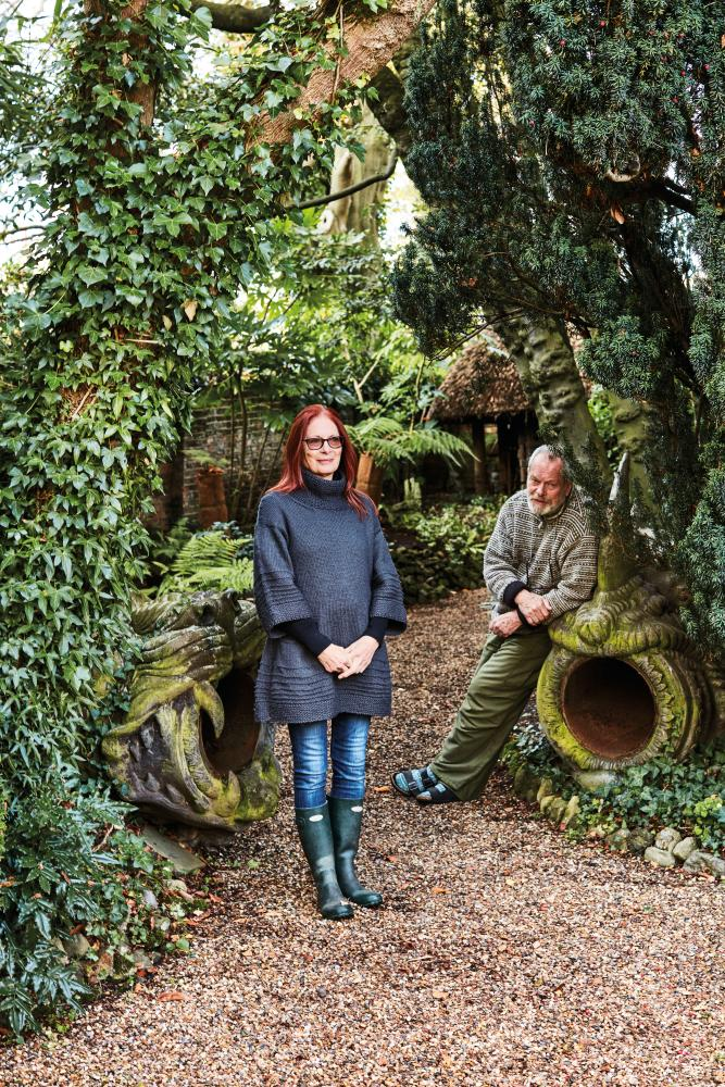 Maggie and Terry Gilliam in their London garden; the lion and rhino cannons are from the set of The Adventures Of Baron Munchausen.