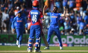 India bowler Mohammad Shami celebrates after dismissing Afghanistan batsman Mujeeb Ur Rahman to complete his hat trick.