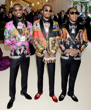 Hip hop trio Migos went for bold sequinned Versace suits, offset by bling, bling and a bit more bling. The rappers Quavo, Offset, and Takeoff are long time fans of the Italian house - their 2013 debut single was entitled Versace.