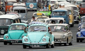 Parade of vintage Volkswagen cars during the Super VW Festival on Le Mans' racing circuit, 2014.