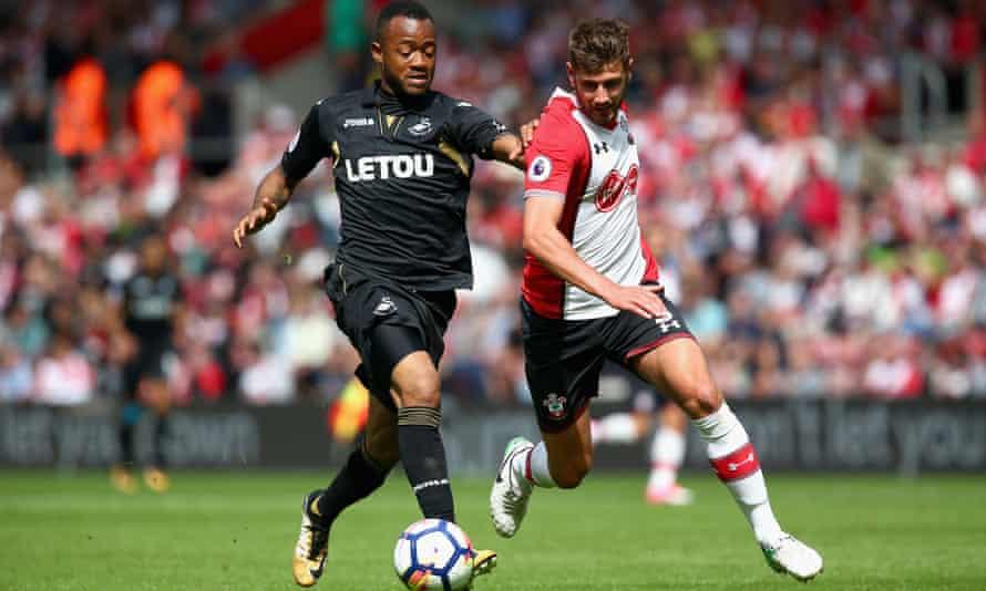 Swansea's Jordan Ayew and Jack Stephens of Southampton battle for possession.