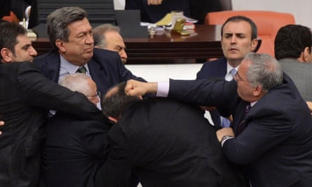 Main opposition Republican People's Party (CHP) and ruling AK Party (R) lawmakers scuffle during a debate on a legislation to boost police powers at the Turkish Parliament in Ankara .