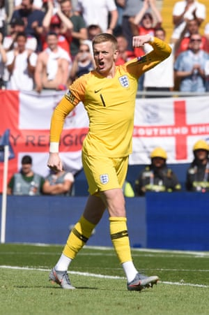 Jordan Pickford of England celebrates scoring his team's fifth penalty.