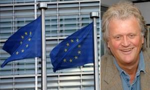 Tim Martin next to EU flags