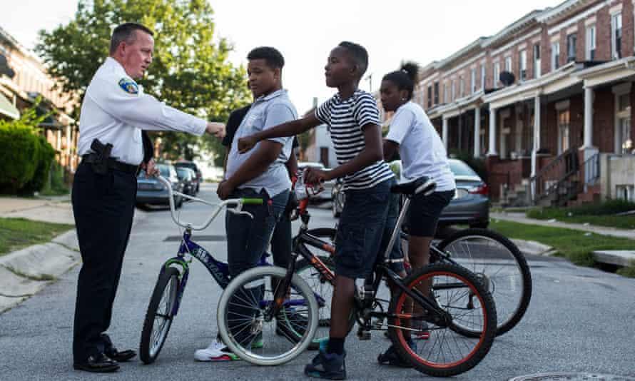 Kevin Davis talks with neighborhood kids in Baltimore last year.