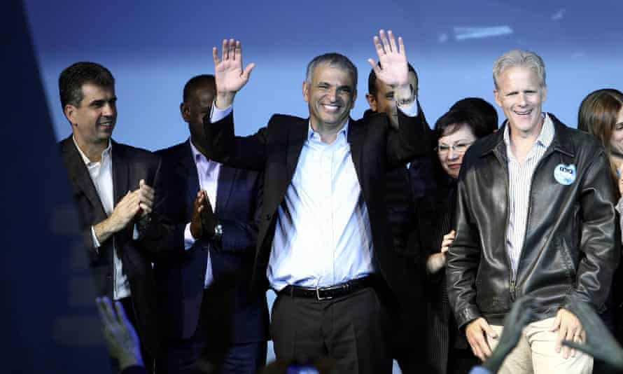 Moshe Kahlon, head of new centre-right party Kulanu, waves to supporters at party headquarters in Tel Aviv.