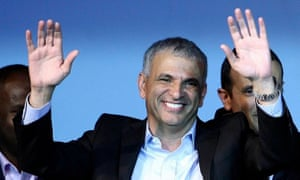 Moshe Kahlon waves to supporters at Kulanu party headquarters in Tel Aviv