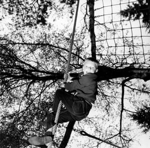 A young boy tackles a commando rope.