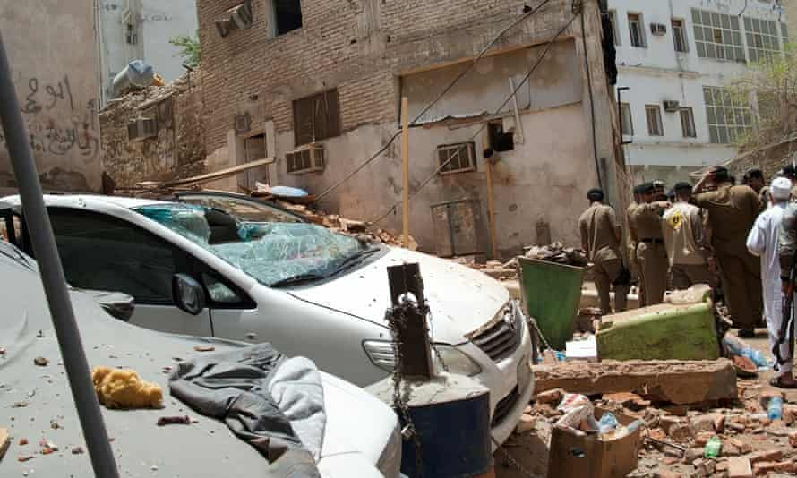 Saudi official inspect a scene of a foiled terrorist attack in Mecca, Saudi Arabia.