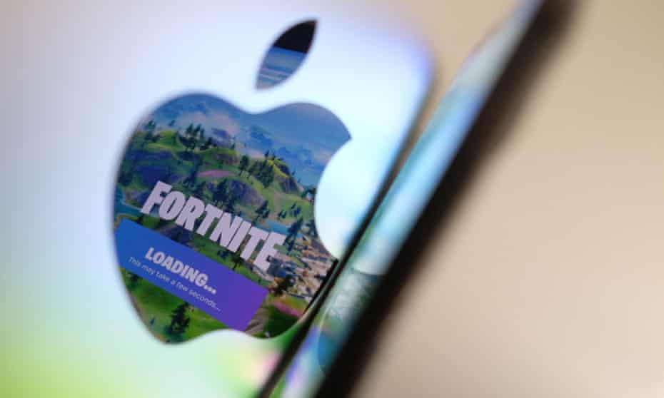 This file illustration photo shows the opening screen of Epic Games Fortnite reflecting onto the Apple logo of the back of an I-mac