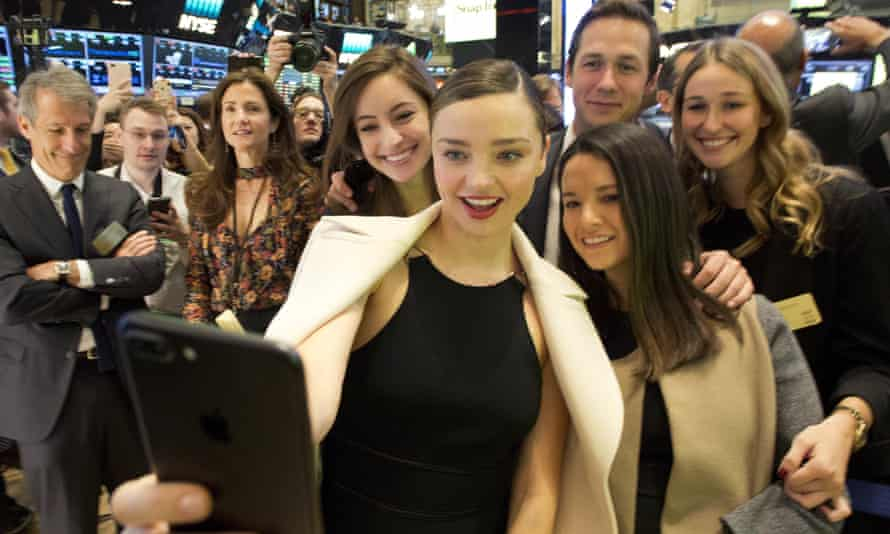 Miranda Kerr, the Australian model, takes a selfie with friends at the opening bell at the New York Stock Exchange on Thursday. Kerr is the partner of Snapchat boss Evan Spiegel.