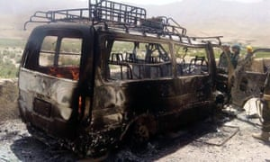 Afghan security officials inspect a van that was believed to have been transporting foreign tourists when it was attacked by militants in Herat province.