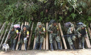 Farc fighters at a demobilization zone, where weapons are handed over as they being the transition. 'Now we are facing a different kind of battle.'