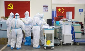 Medical staff in protective suits work at Wuhan Fang Cang makeshift hospital in Wuhan
