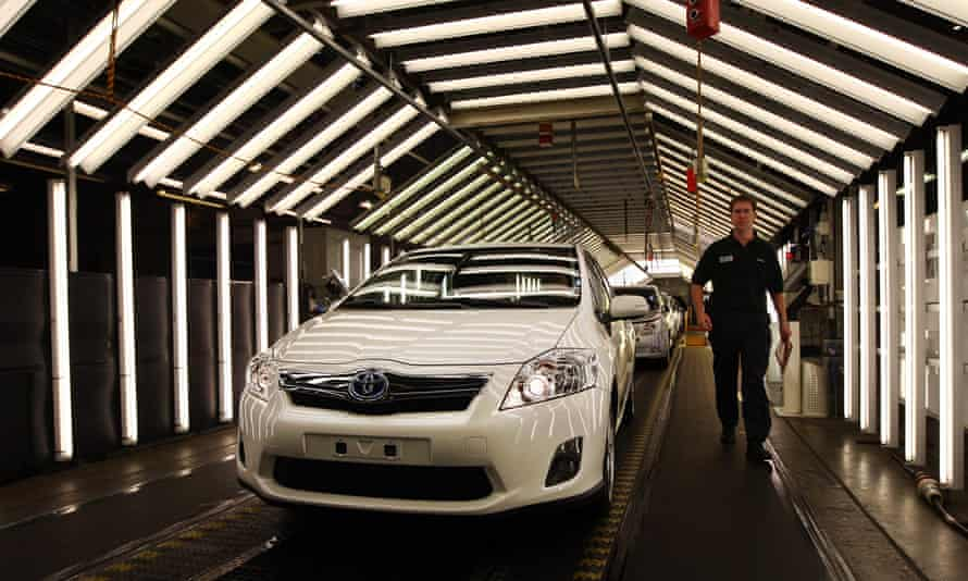 A Toyota Auris hybrid car is leaves the production line at the Burnaston plant near Derby.