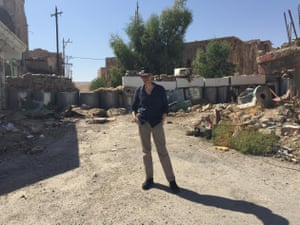 Eerie … Tom Holland trudges alone through the rubbled piles of stone and concrete in Sinjar, Iraq.
