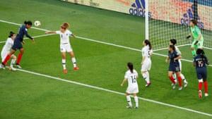Wendie Renard heads a goal.