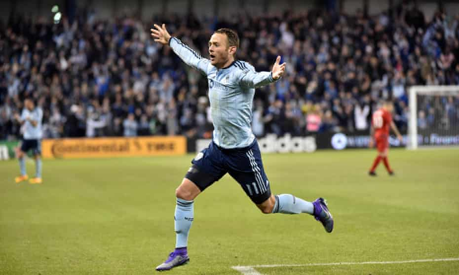 Sporting KC's Brad Davis celebrates his game-winner against Toronto FC. KC are top of the East with three wins from three.