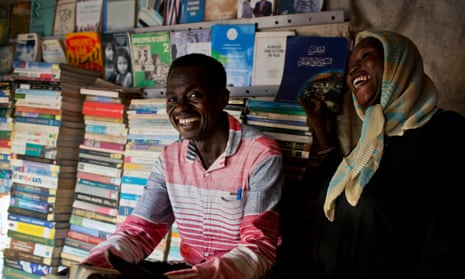 Juma Ali, 34, centre, a Christian from the Nuba Mountains in Sudan who fled to Malakal in South Sudan, in his bookshop in the camp.