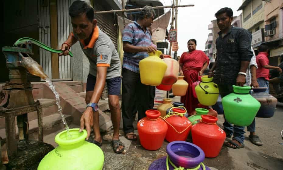 People stand in line for supplies from the daily water deliveries in Chennai where shortages have reached crisis point.