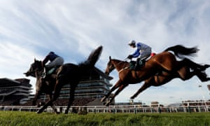 Barters Hill, blue and white colours, clears a fence in the Steel Plate And Sections Novice Chase at Cheltenham on Friday.