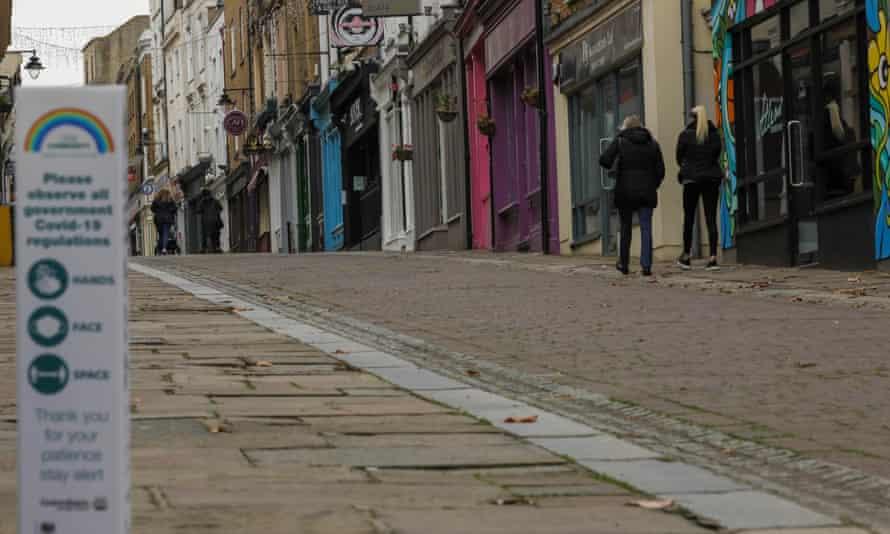 People walk past closed shops in Gravesend, Kent