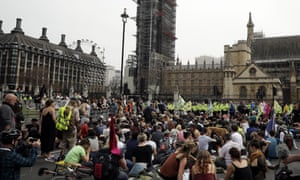 Protesters sit in the road in Parliament Square