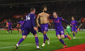 Mohamed Salah is mobbed by his Liverpool teammates after running from the halfway line to score his side's crucial second goal at Southampton.
