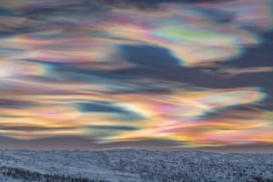 Skyscapes winner: Painting the Sky by Thomas Kast (Germany) The photographer was searching for clear skies in Finnish Lapland to capture the beauty of a polar night and could not believe his eyes when he saw what was waiting behind the clouds. Polar stratospheric clouds are something Kast had been searching for many years and had seen only in photographs until that day. He took his camera on to a frozen river to get a good view and started to take photos. The clouds slowly changed their shape and colours to create a painterly image