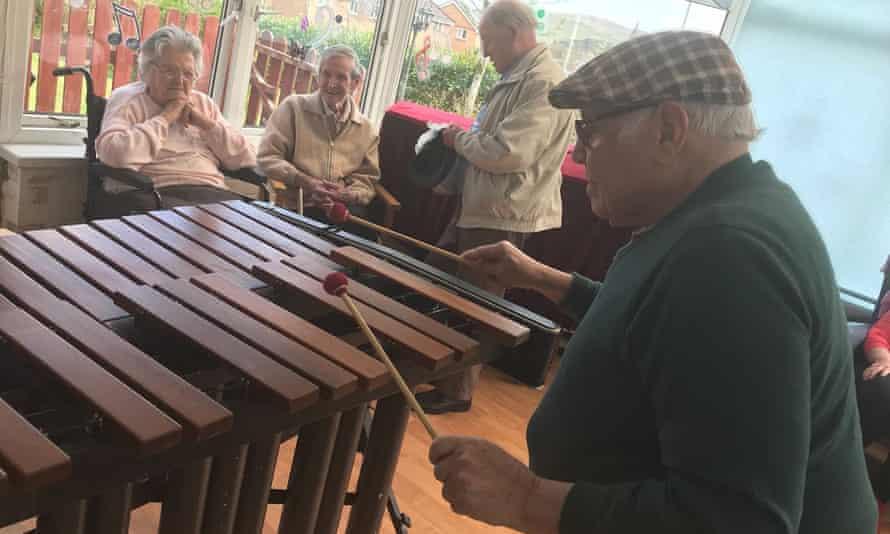 Older people playing xylophone