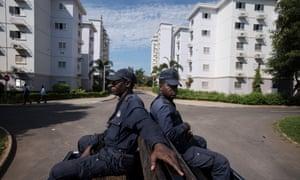Police on patrol at the new Kilamba development.