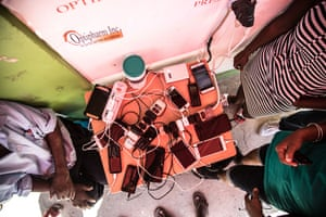 A plug dangling from a private clinic becomes a vital charging station. With power out across 99% of the island, residents are desperate to charge their phone to communicate with friends and family abroad or across Dominica.