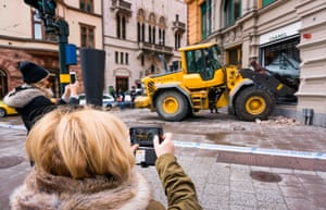 Stockholm, SwedenPeople take pictures of a scene of a failed smash and grab attack on a Chanel boutique