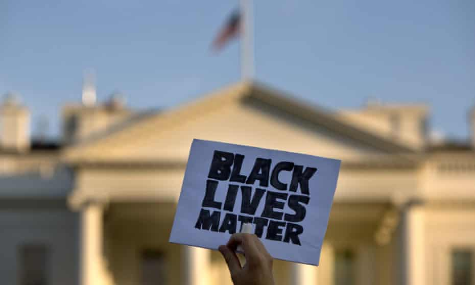 A sign at a protest in front of the White House in Washington.