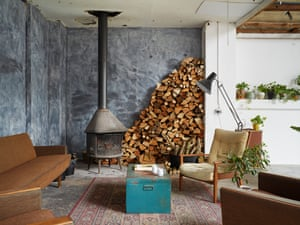 Up in smoke: a wood-burning stove and reclaimed furniture.