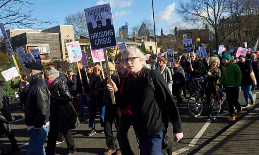 Demonstrators take part in a protest opposing the  government's housing bill, in central London.