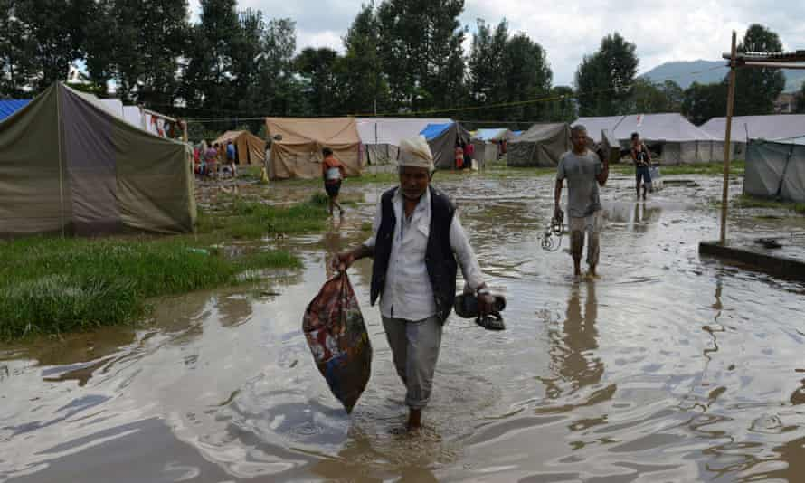 Nepalese earthquake victims at a temporary shelter after monsoon rains on the outskirts of Kathmandu. Micro-insurance schemes can offer a safety net for families after emergencies.