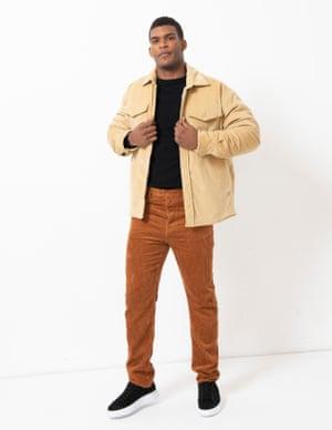 model wears jacket, £435, nanushka.com. Corduroy trousers, £45, weekday.com. Trainers, £195, russellandbromley.co.uk. Rucksack, £120, woodwood.com. Bottle, £25, by Corkcicle, from topshop.com.