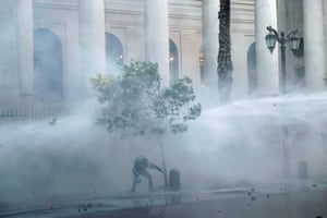 A jet of water is blasted during an anti-government protest in Santiago, Chile
