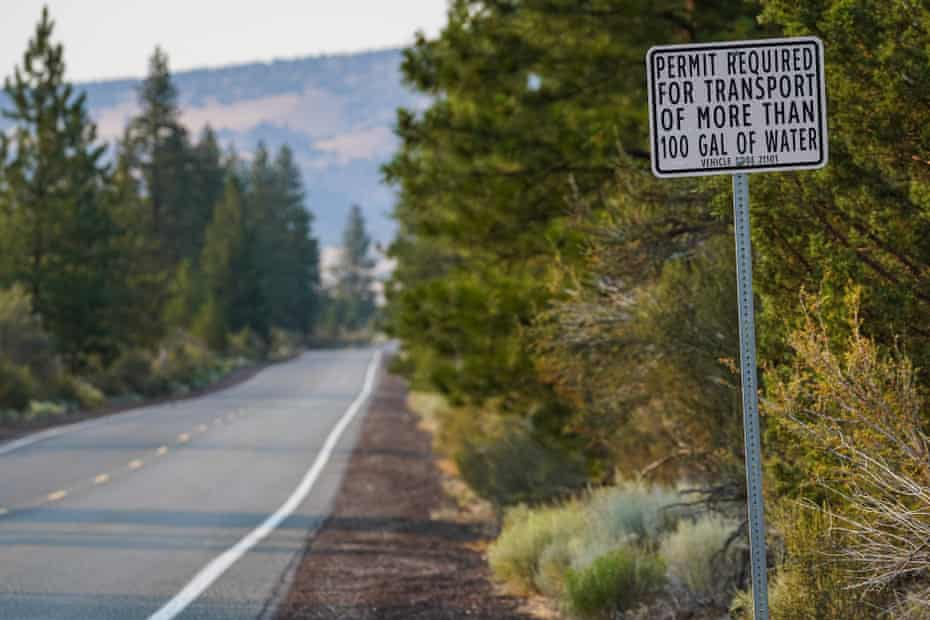 """A sign stating """"Permit required for transport of more than 100 gal of water"""""""