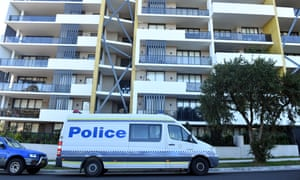 Police vans at a locked-down apartment building in Campbelltown, Sydney.