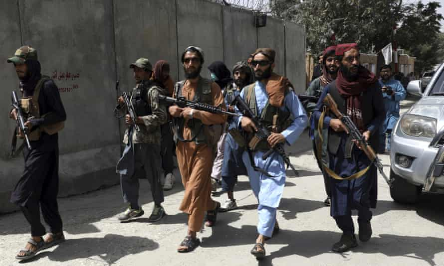 Taliban fighters in Kabul, 18 August.