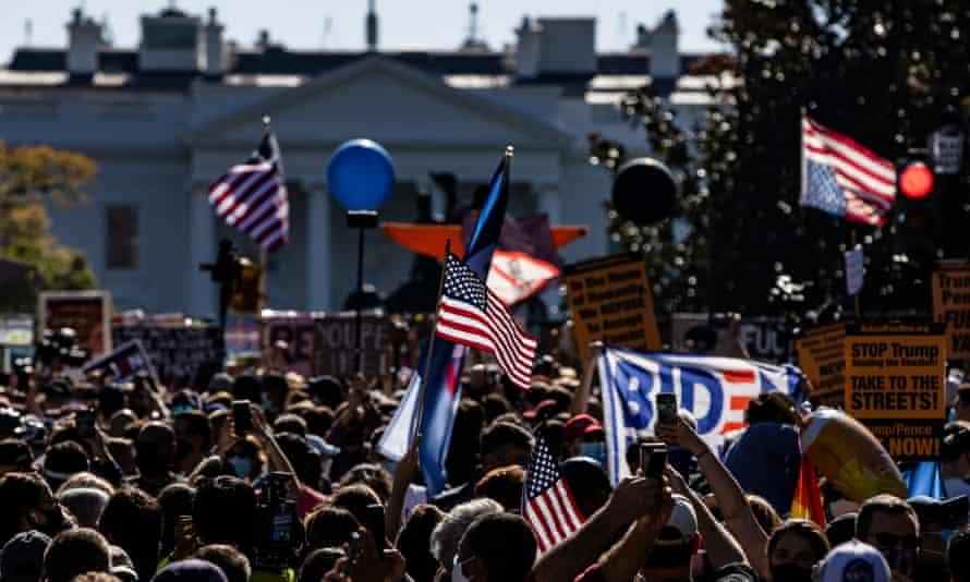 People gather at Black Lives Matter Plaza to celebrate Joe Biden's victory over Donald Trump, 7 November 2020, in Washington DC