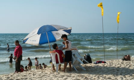 Families on one of Gaza beaches where almost 73 percent of the coastline is currently contaminated with sewage because of the strip's ongoing electricity crisis.