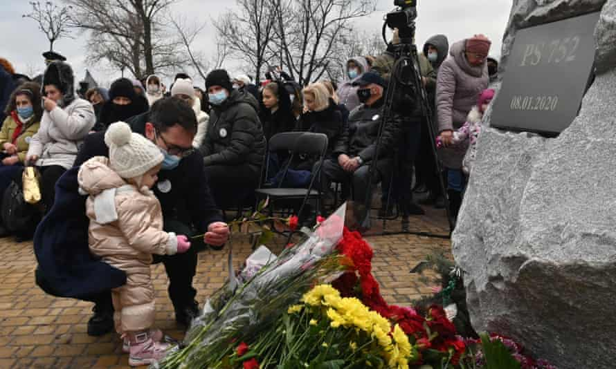 A man lays flowers during a commemorative ceremony with relatives, friends and colleagues of the crew and passengers of Ukraine International Airlines Flight 752, shot down in Iran a year before, on 8 January.