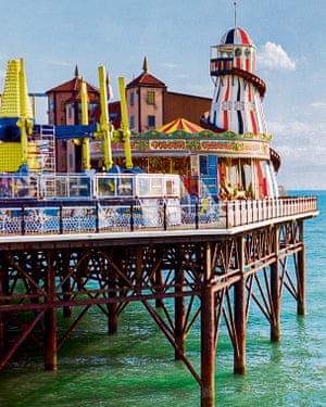 Brighton Palace Pier With Anonymous SwimmerStock photo of the Brighton Palace Pier with an anonymous swimmer in the water.